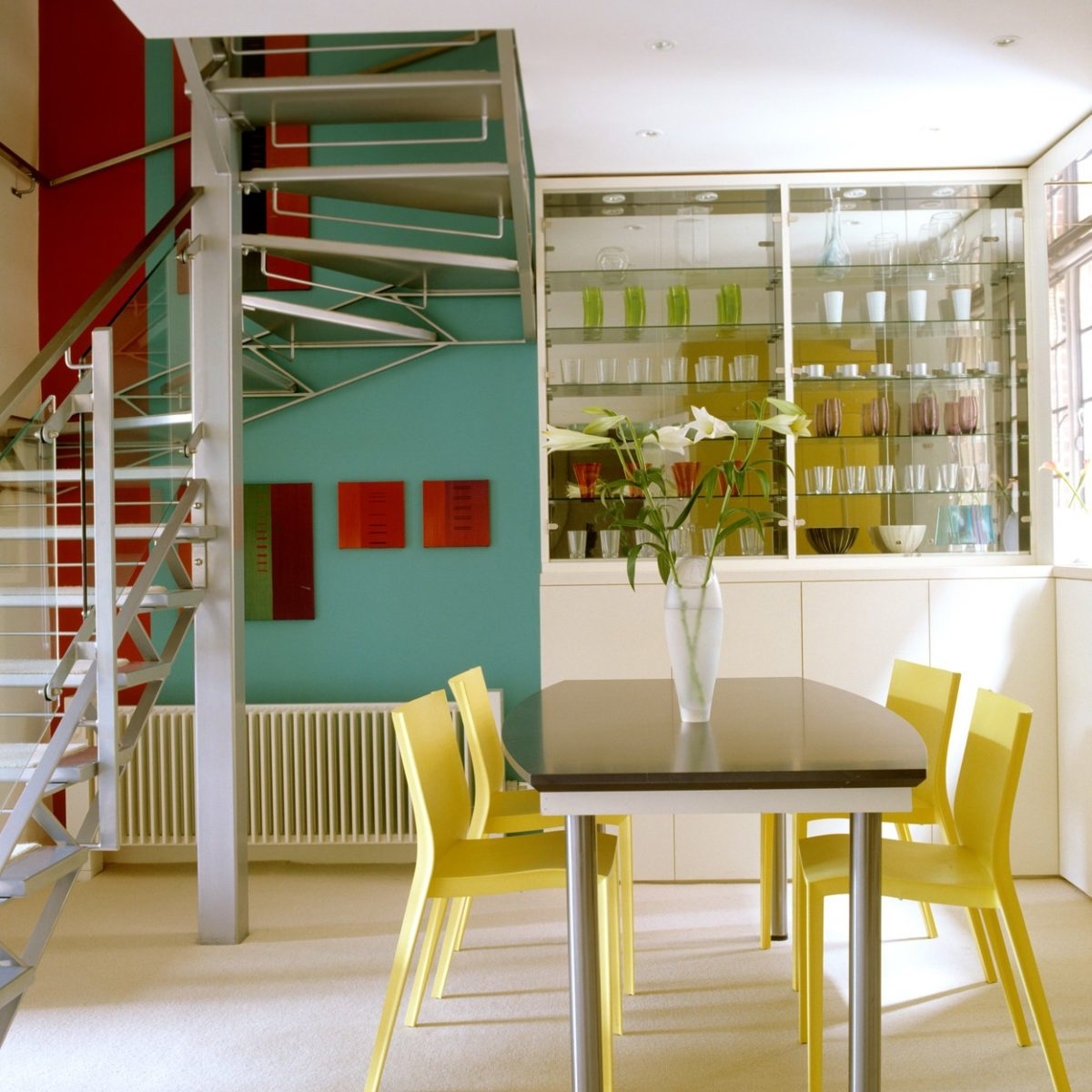 1930s mansion flat renovated with striking stainless steel and glass central staircase
