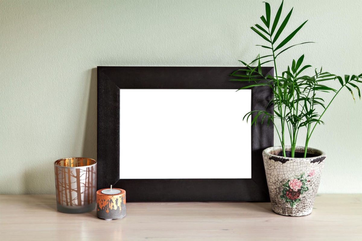 Image of frame mockup scene with plant and candle holders.