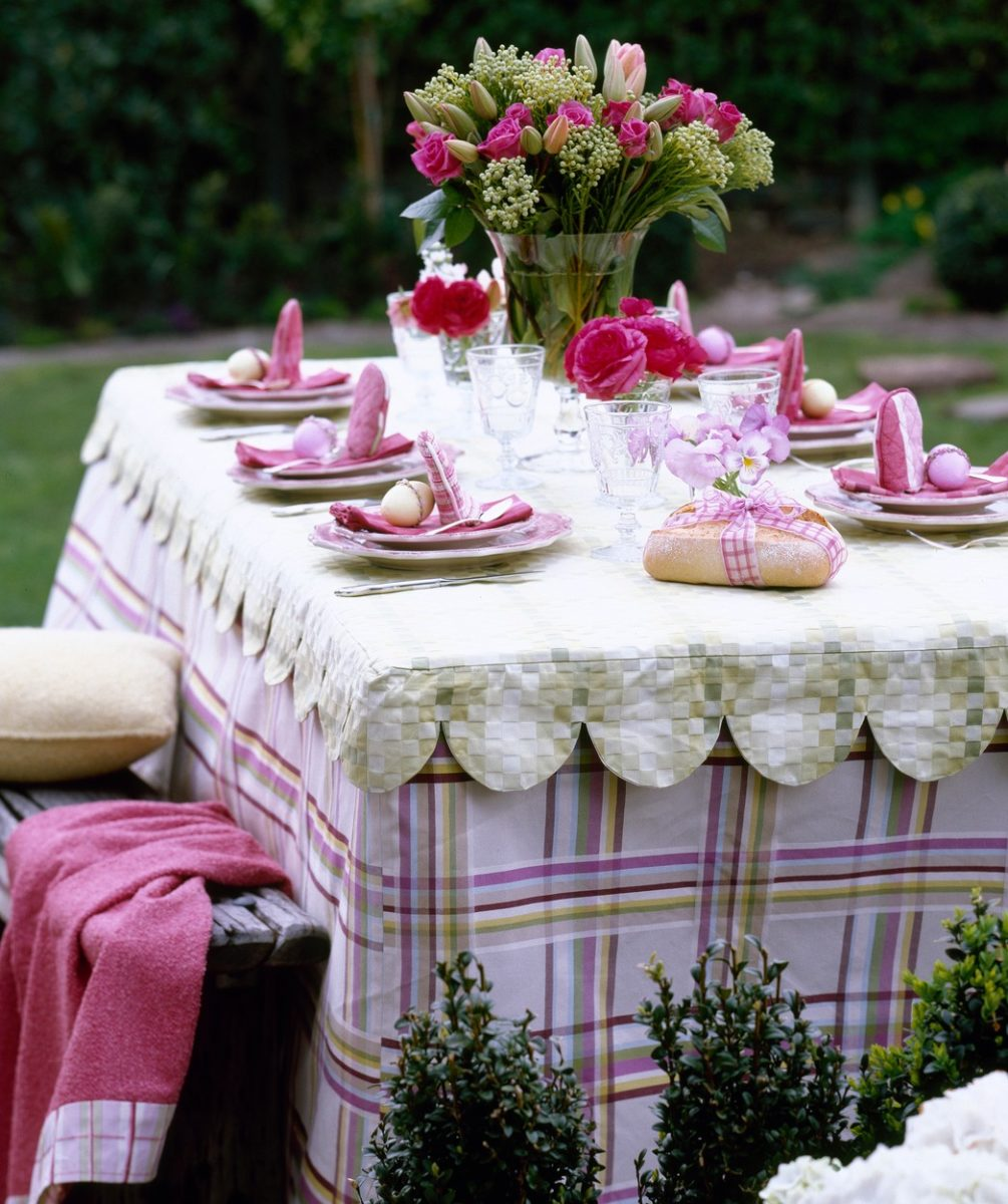 """Table set outdoors for Easter celebration party,"""